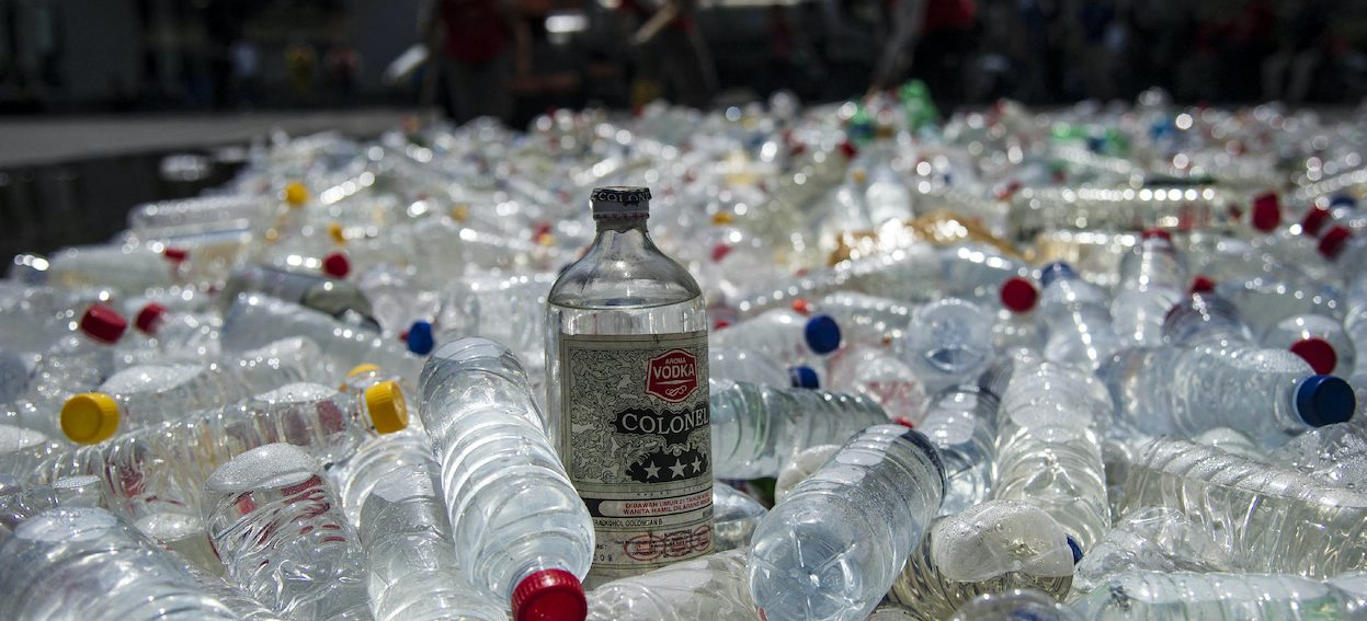 Bottles of bootleg alcohol are ready to be destroyed after a recent raid in Surabaya on 25 April, 2018. Photo: Juni KRISWANTO/ AFP)