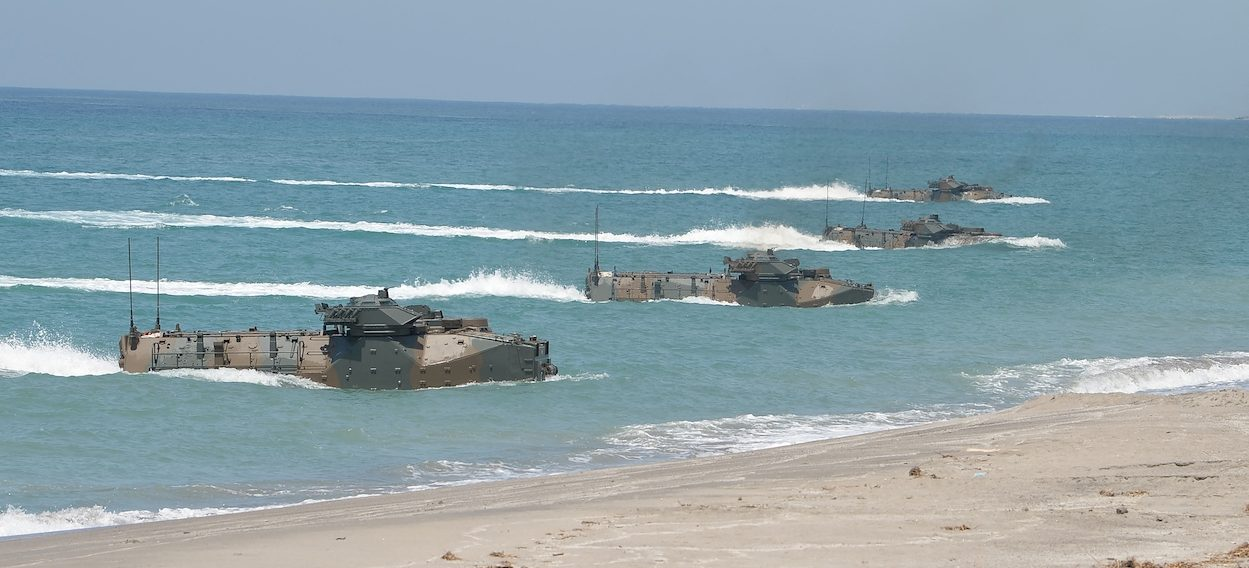 Japanese Ground Home Defence Forces Amphibious Assault Vehicles (AAV) hit the beach of the Philippine navy training centre facing the South China Sea in San Antonio town, Zambales province, north of Manila on 6 October, 2018, as they join the annual joint US-Philippine marines exercises. (Photo: Ted ALJIBE/ AFP)