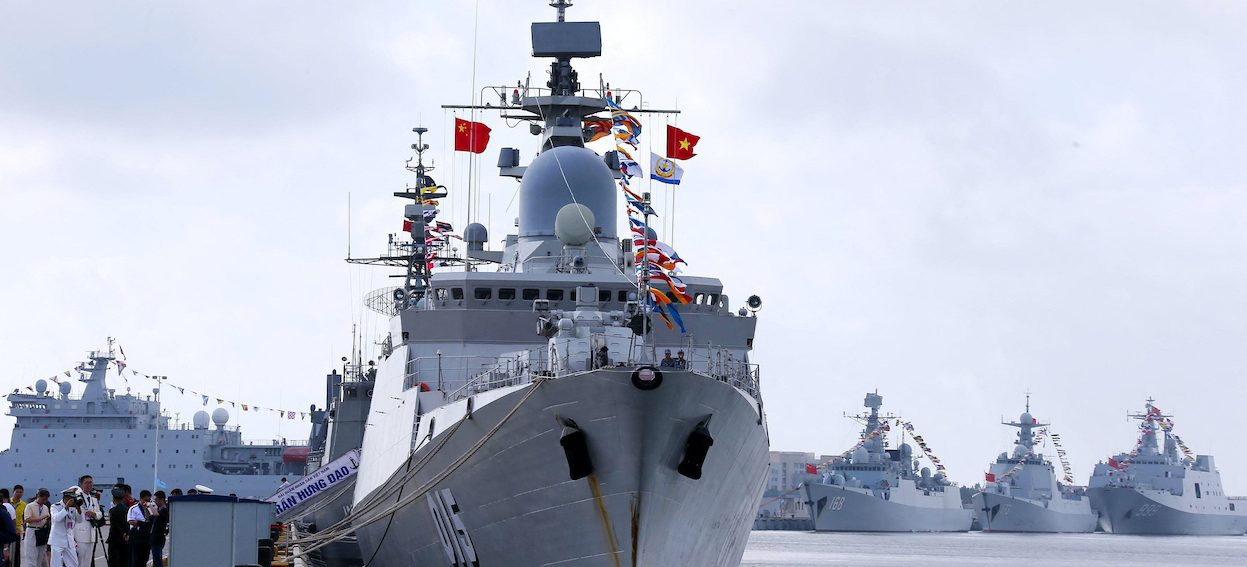 A Vietnamese navy ship (L) near Chinese navy ships at a military port in Zhanjiang, in China's southern Guangdong province as part of a China-ASEAN joint maritime exercise on 22 October, 2018, to ease tensions in the South China Sea. (Photo: STR/ AFP)
