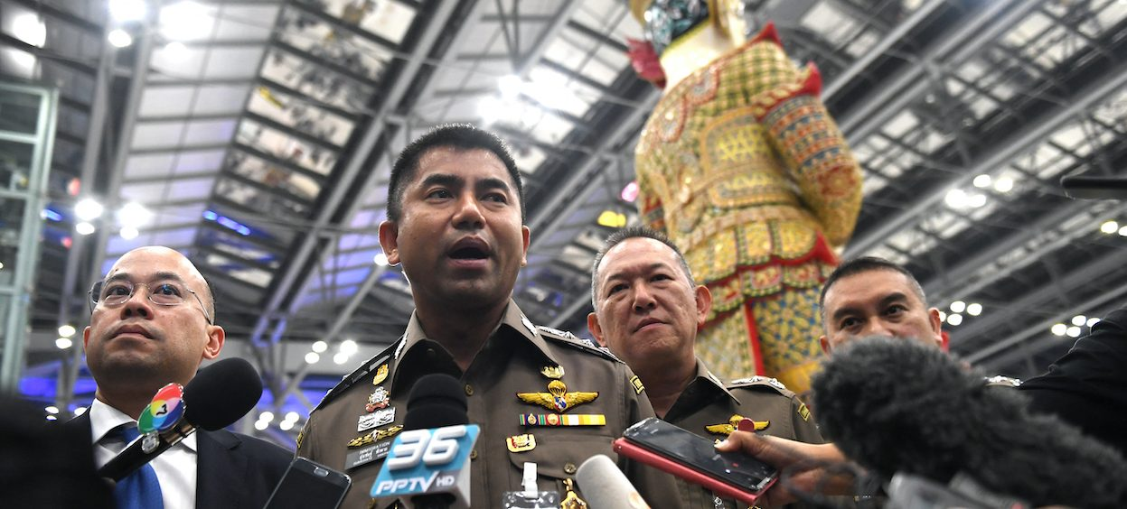 """Former Thai immigration police chief Surachate """"Big Joke"""" Hakparn speaks to journalists at Suvarnabhumi airport in Bangkok on 11 January, 2019. Hakparn has been reappointed in the latest set of partisan reshuffles after being mysteriously ousted in 2019. (Photo: Lillian SUWANRUMPHA/ AFP)"""