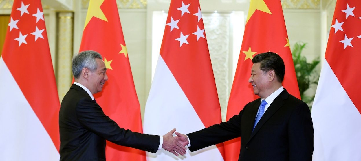 Singapore's Prime Minister Lee Hsien Loong (L) shakes hands with China's President Xi Jinping (R) before their meeting at the Great Hall of the People in Beijing on April 29, 2019. (Photo by MADOKA IKEGAMI / POOL / AFP)