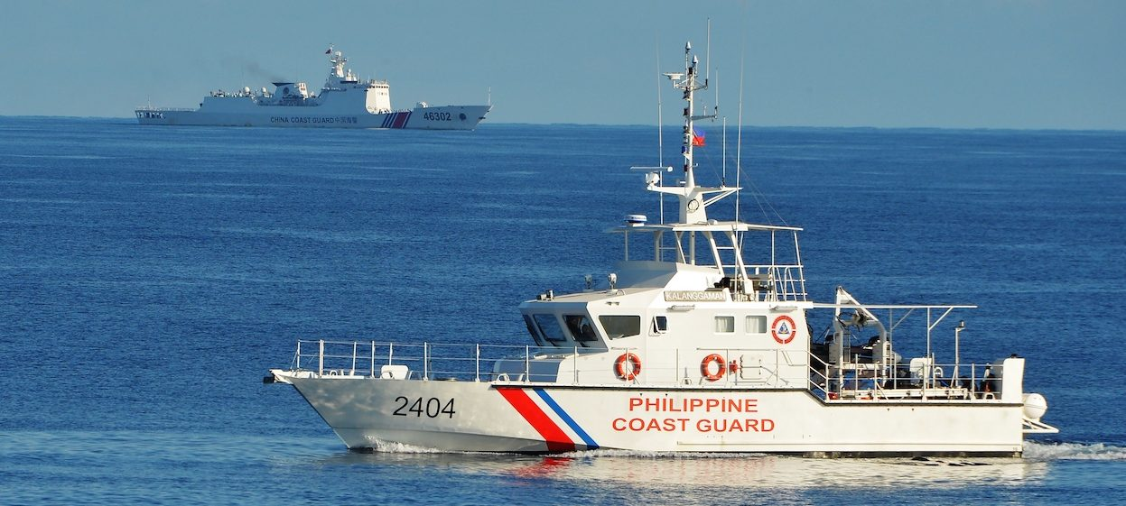 A Philippine coast guard ship (R) sails past a Chinese coastguard ship during an joint search and rescue exercise between Philippine and US coastguards near Scarborough shoal, in the South China Sea, on 14 May, 2019. (Photo: Ted ALJIBE/ AFP)