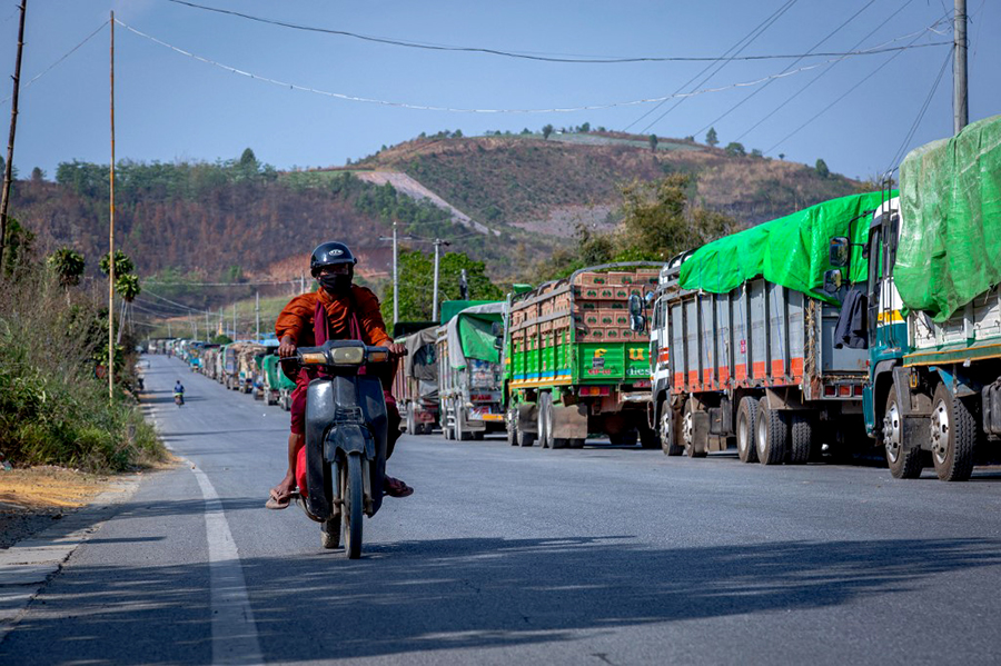 A line of trucks carrying melons waiting to enter China near the Myanmar