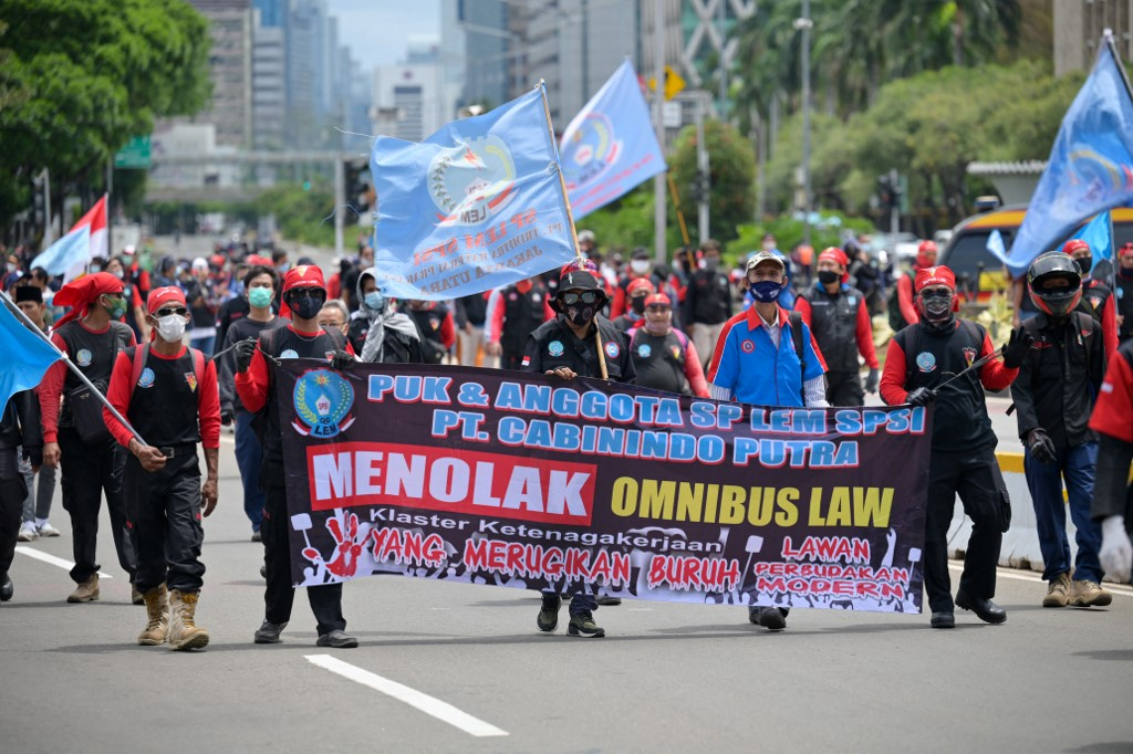 Labourers take part in a rally against a controversial new law which critics fear will favour investors at the expense of labour rights and the environment in Jakarta.