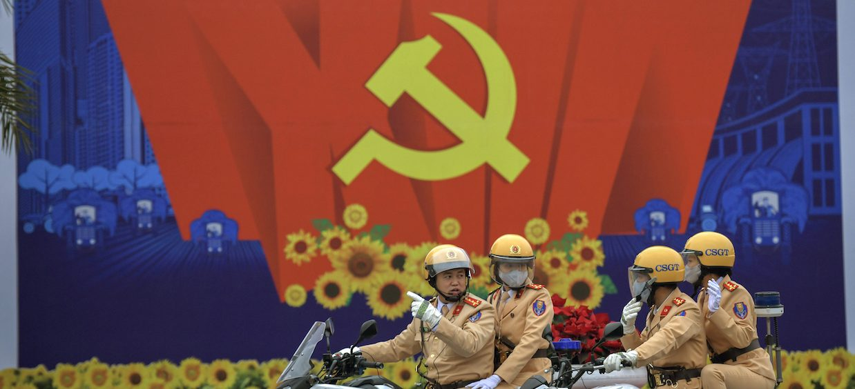 Security forces drive past a billboard for the Communist Party of Vietnam's (CPV) 13th National Congress outside the National Convention Centre in Hanoi on 26 January, 2021. The CPV's 13th National Congress, which will conclude on 2 February 2021, could see a break in established traditions of the Party. (Photo: Nhac NGUYEN/ AFP)