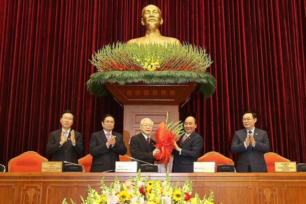 Vietnam's Prime Minister Nguyen Xuan Phuc (2R) congratulating the new Communist Party general secretary Nguyen Phu Trong (centre L) after his re-election during the Communist Party of Vietnam (CPV) 13th National Congress in Hanoi, as other nominated top party leaders Vuong Dinh Hue (R), Pham Minh Chinh (2L) and Vo Van Thuong (L) applaud. (Photo: STR/ Vietnam News Agency/ AFP)