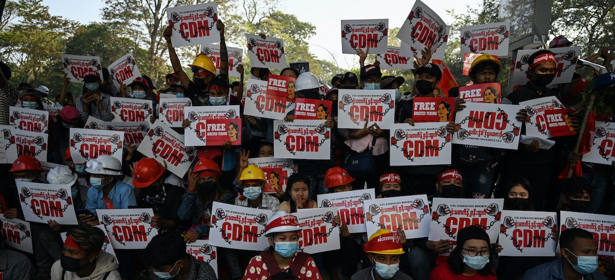 Protesters hold up signs supporting the Civil Disobedience Movement (CDM) at a demonstration against the military coup in Yangon on 14 February, 2021. (Photo: Ye Aung THU/ AFP)