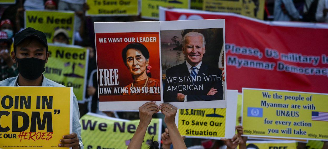 A protester holds a sign calling for the release of detained Myanmar civilian leader Aung San Suu Kyi and US President Joe Biden during a demonstration against the military coup outside the US embassy in Yangon on 15 February, 2021. (Photo: YE Aung Thu/ AFP)