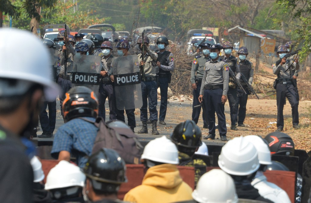 Riot police face off with protesters during a demonstration against the military coup in Naypyidaw