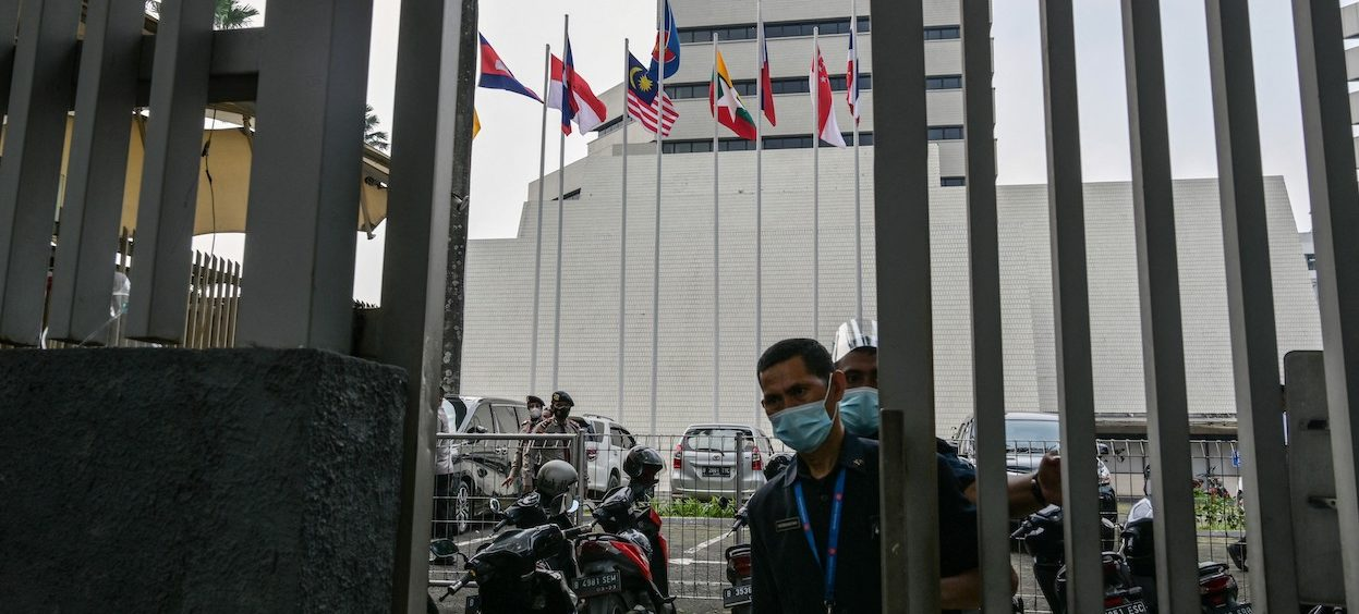 Security personnel stand guard at the gate of the Association of Southeast Asian Nations (ASEAN) building in Jakarta on 23 April, 2021, ahead of the ASEAN summit on the Myanmar crisis. (Photo by Bay ISMOYO/ AFP)