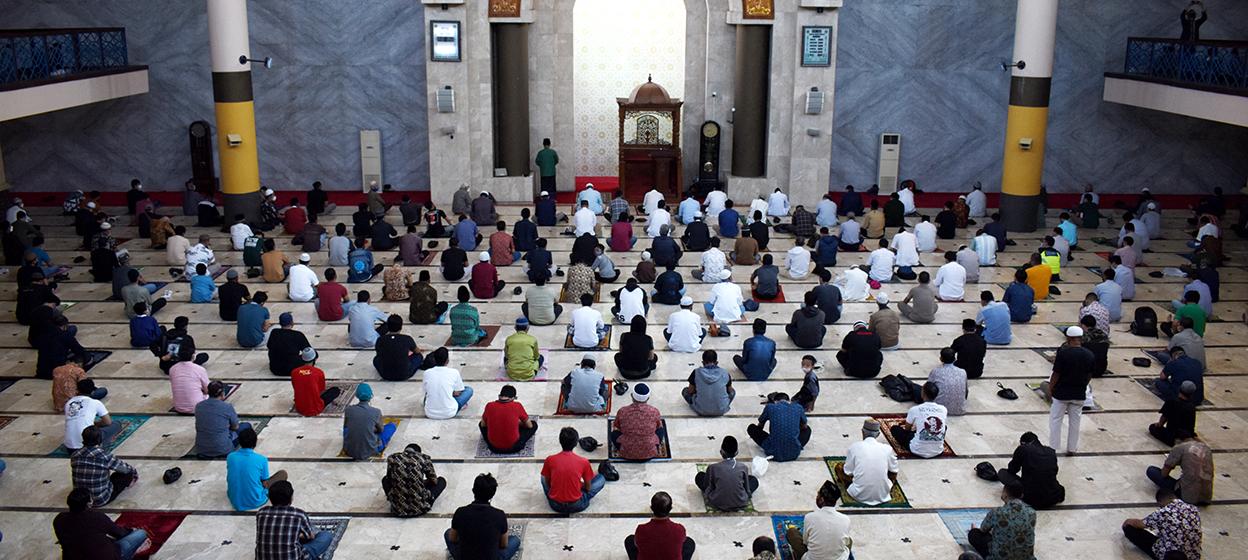 Muslims observe Covid-19 coronavirus social distancing measures during Friday prayers