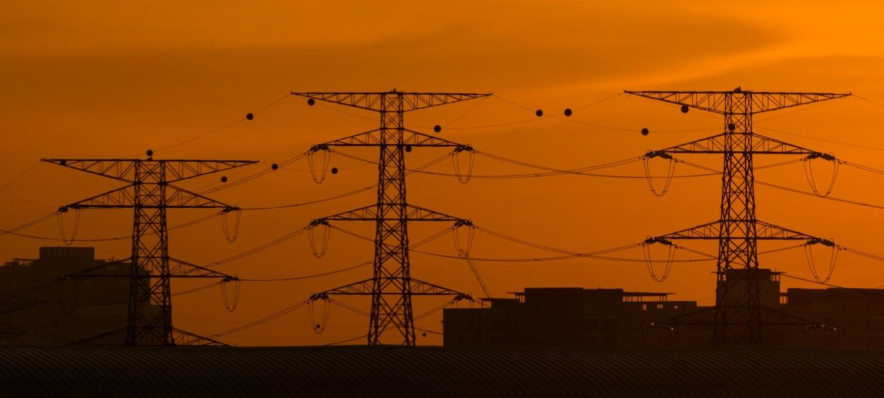 Electricity power transmission lines are pictured during the sunset in Petaling Jaya, near Kuala Lumpur on 21 August, 2021. (Photo: Mohd RASFAN / AFP)