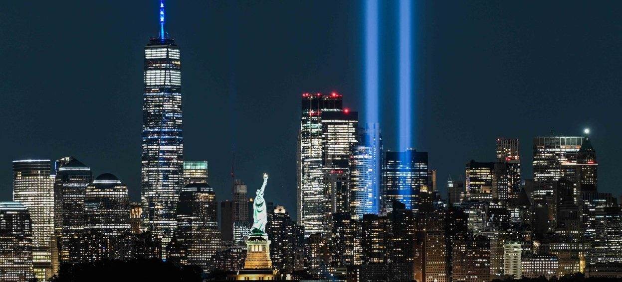 The Statue of Liberty shines on 11 September, 2021 near the Tribute in Light as part of the commemoration for 20th anniversary of the terrorist attack in New York City. (Photo: Roberto SCHMIDT/ AFP)