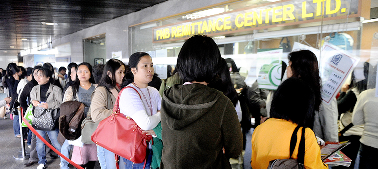 Filipino domestic helpers line up