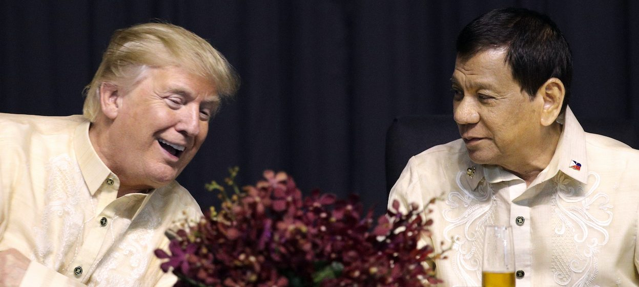 US President Donald Trump (L) speaks with Philippines President Rodrigo Duterte during a special gala celebration dinner for the Associate of Southeast Asian Nations (ASEAN) in Manilla on 12 November, 2017. The Philippines and US enjoyed warm bilateral relations when Trump was in office, but the 70-year old alliance may be tested with the new Biden administration. (Photo: Athit PERAWONGMETHA/ POOL/ AFP)