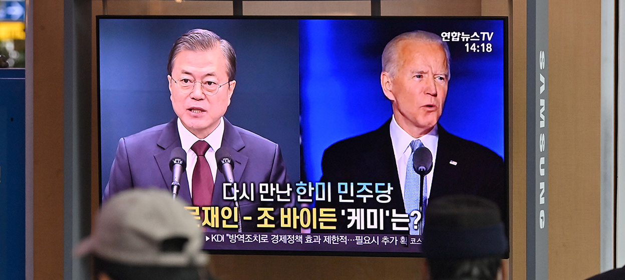 Joe Biden (R) and South Korean President Moon Jae-in