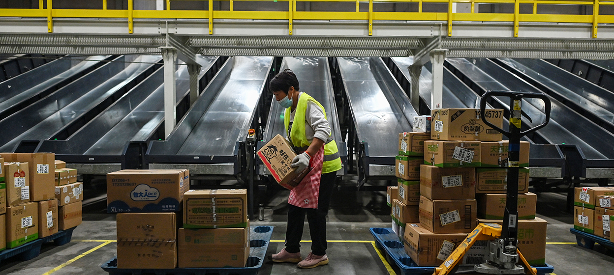 An employee works in the warehouse of Cainiao Smart Logistics Network