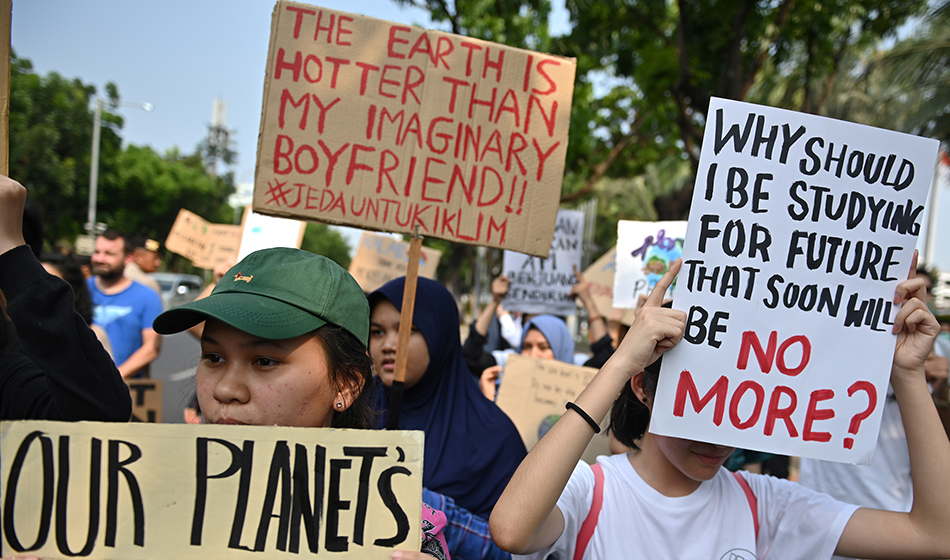 Indonesian activists participate in a rally calling for action against climate change