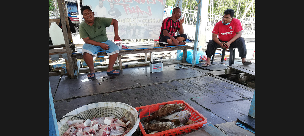 Fishermen waiting with their catch