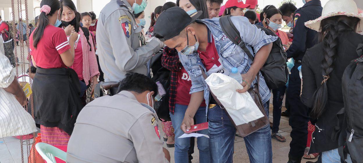 Myanmar nationals wearing facemasks