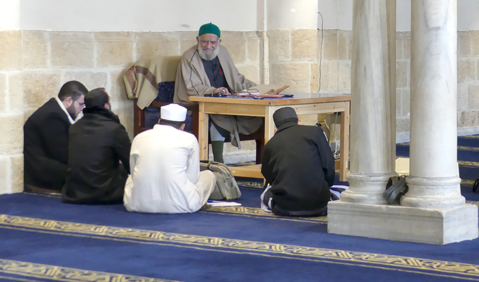 Informal learning classes conducted at the mosque between a Shaikh and students.