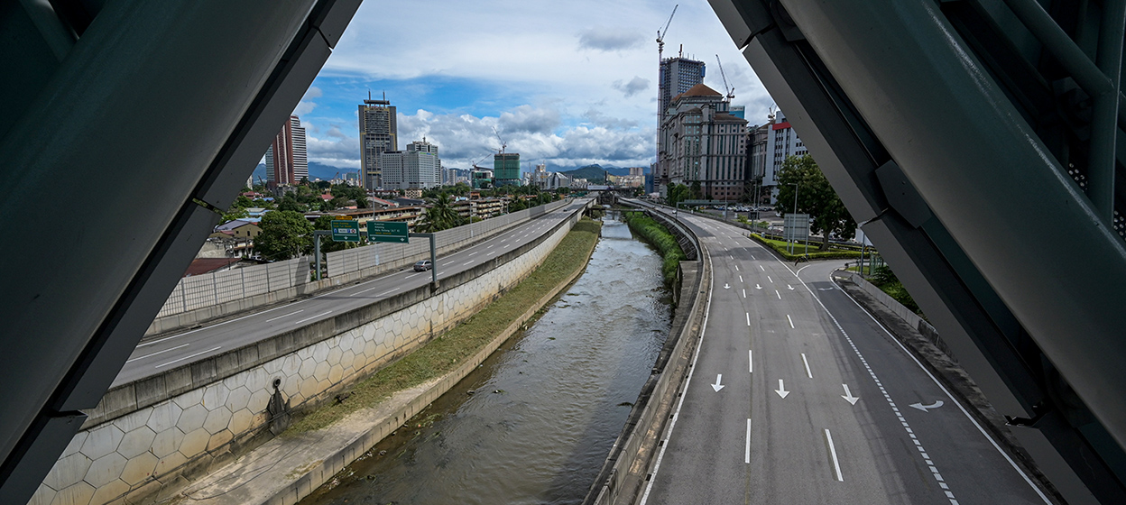 Motorists travel on the near-deserted Ampang-Kuala Lumpur Elevated Highway