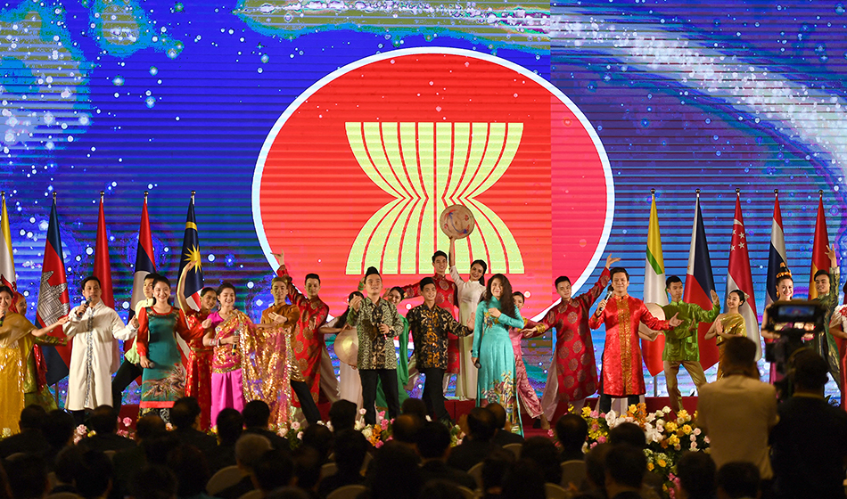 Artists perform on stage at the end of the opening ceremony of the ASEAN Summit