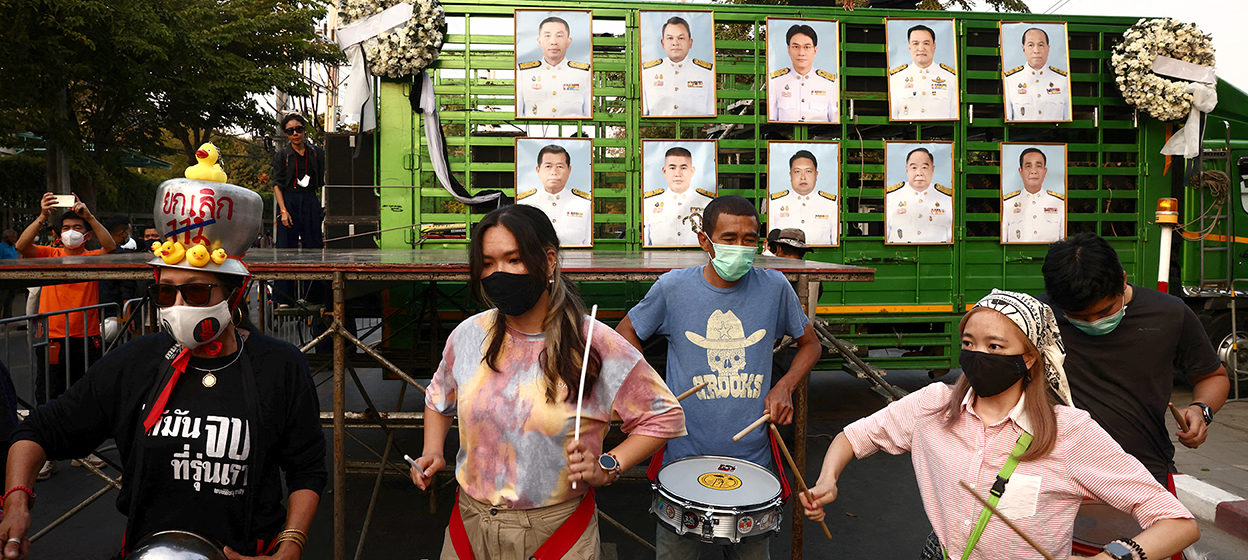 Pro-democracy protesters display a portrait of Thai Prime Ministers Prayut Chan-O-Cha