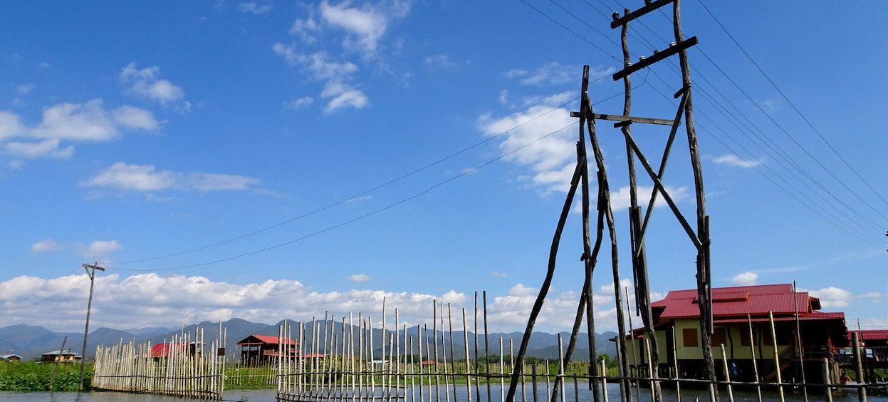 Photo of a utility pole in Myanmar, on 12 December, 2016. Myanmar's current lack of a reliable electricity source is a hurdle to the economic growth that it needs. (Photo: Claire BACKHOUSE/ Flickr)