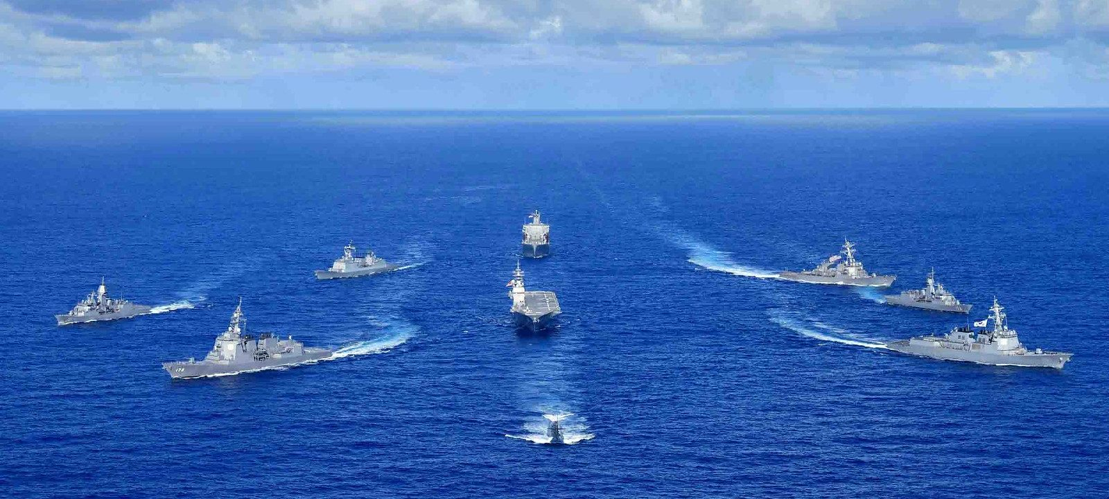 Royal Australian Navy, Republic of Korea Navy, Japan Maritime Self-Defense Force, and United States Navy warships sail in formation during the Pacific Vanguard 2020 exercise.