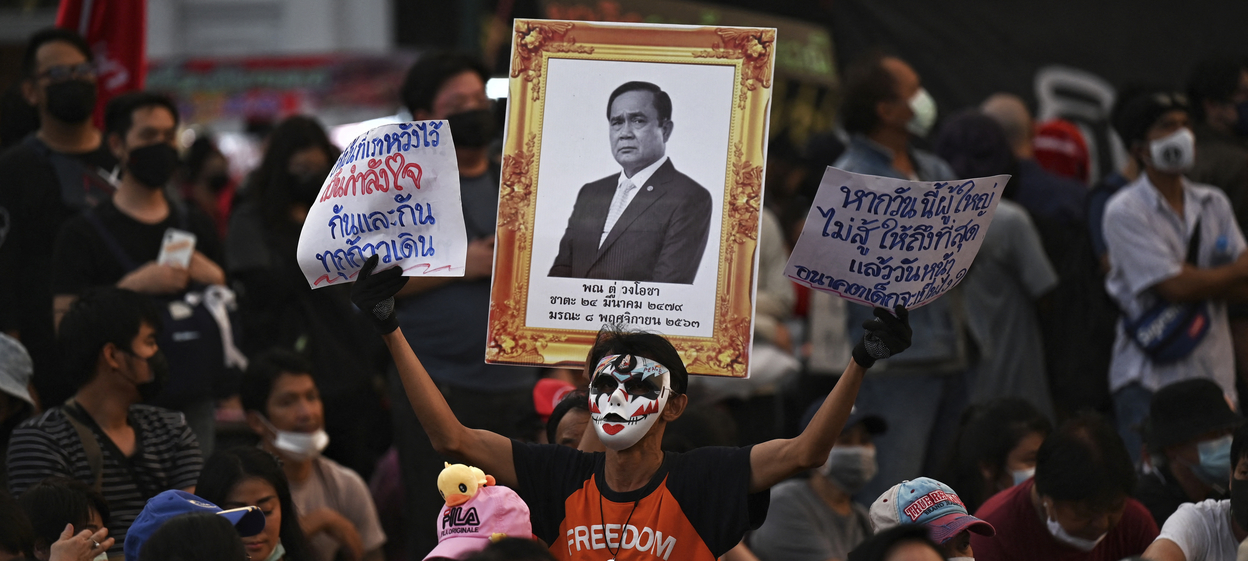 Anti-government protesters display a mock funeral portrait of Thai prime minister Prayut Chan-o-Cha during a demonstration