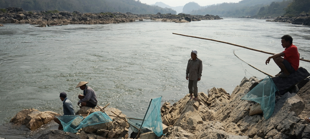 Fishermen laying their nets on the Mekong River