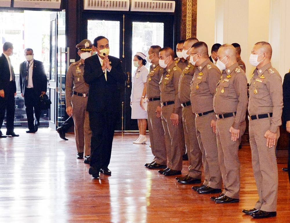 Prime Minister and Defense Minister General Prayut Chan-ocha waving to military leaders at the Royal Thai Police Headquarters, Bangkok.