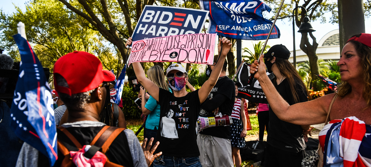 Supporters of former US President Donald Trump and US President Joe Biden gather outside the hotel where the Conservative Political Action Conference 2021 (CPAC) is being held.