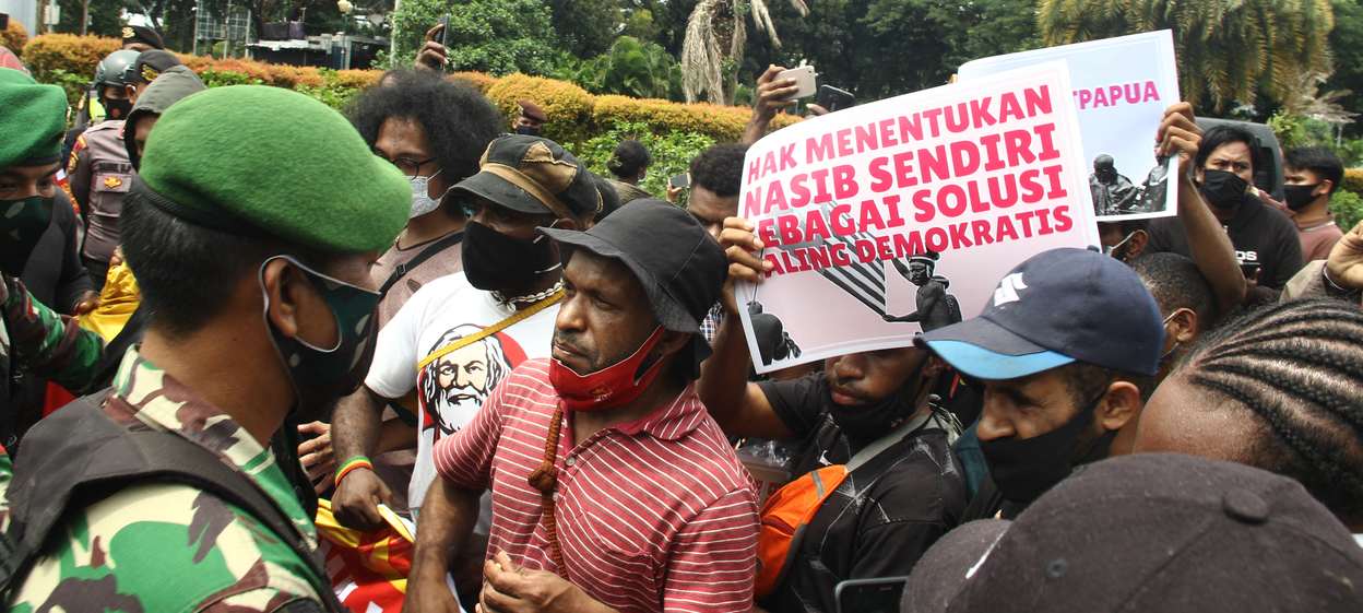 A group of Papuan pro-independence protestors face off with police in Jakarta.