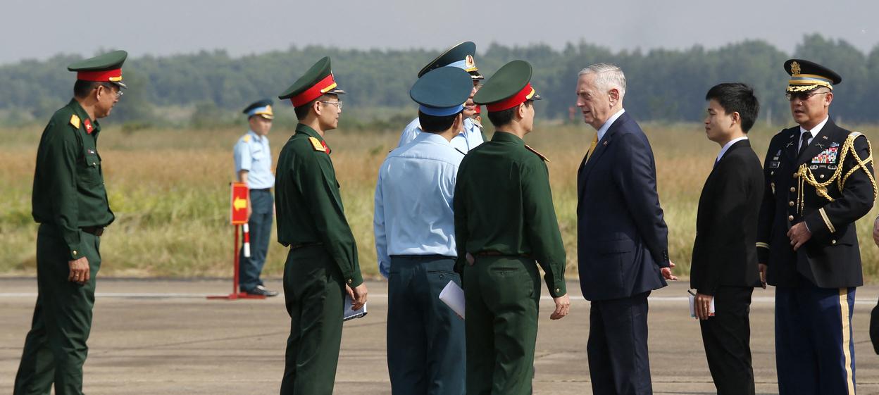 US Secretary of Defense Jim Mattis (3rd-R) talks to Vietnamese military officials